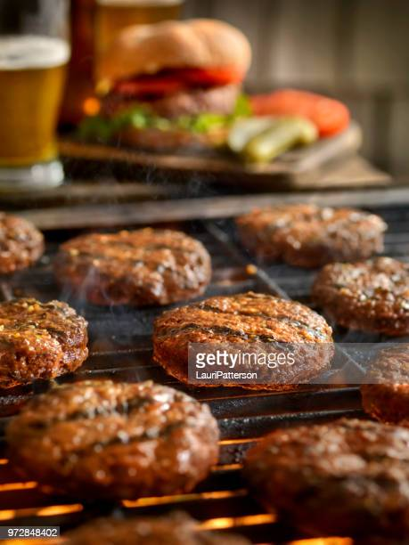 Hamburgers on the BBQ with Beers