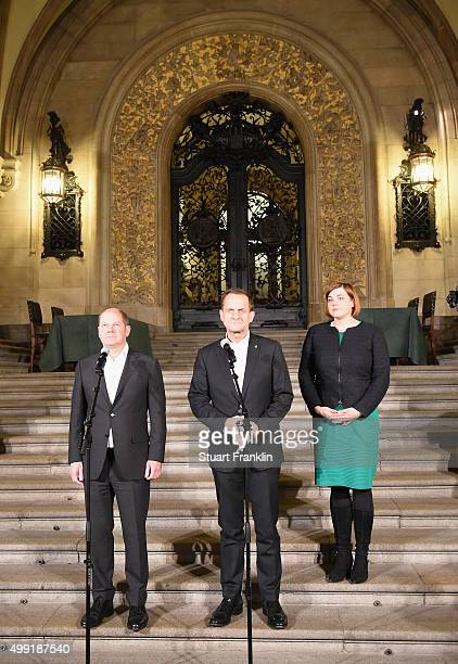 Hamburg's Burgermeister Olaf Scholz Alfons Hörmann DOSB president and Katharina Fegebank at the Rathaus as the results of the referendum on Hamburg's...