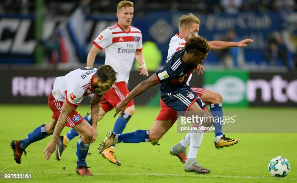 Hamburg's Dennis Diekmeier Hamburg's Andre Hahn Hamburg's Lewis Holtby and Munich's Kingsley Coman vie for the ball during the German Bundesliga...