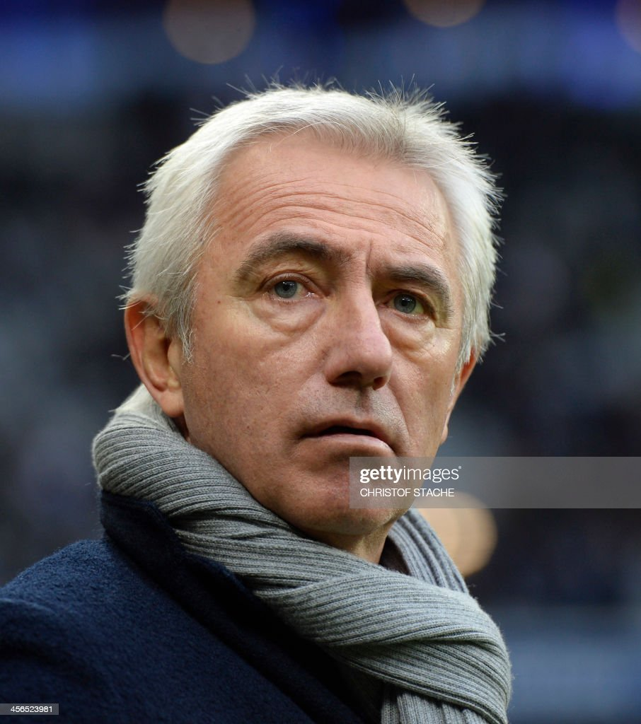 Hamburg's Dutch headcoach Bert van Marwijk waits ahead of the German first division Bundesliga football match between FC Bayern Munich and Hamburger SV on December 14, 2013 at the stadium in Munich, southern Germany. AT + 49 69 650050.
