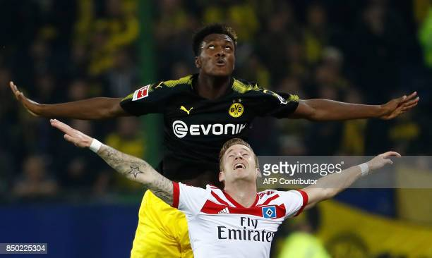 Hamburg's German forward Andre Hahn and Dortmund's French defender DanAxel Zagadou vie for the ball during the German first division Bundesliga...