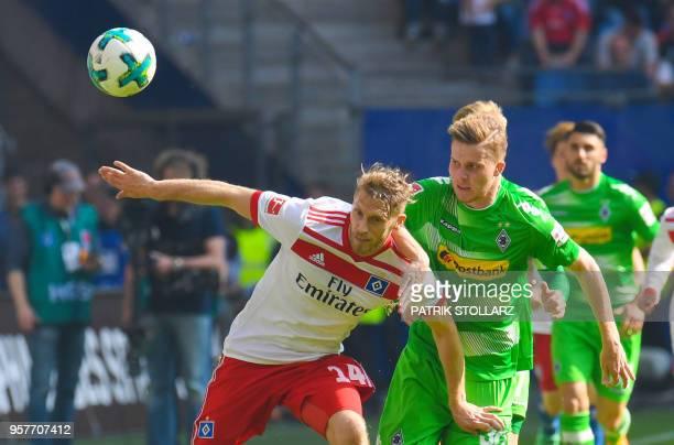 Hamburg's German midfielder Aaron Hunt and Moenchengladbach's Swiss defender Nico Elvedi vie for the ball during the German first division Bundesliga...