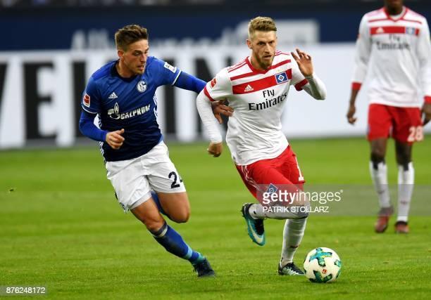 Hamburg's German midfielder Aaron Hunt and Schalke's German defender Bastian Oczipka vie for the ball during the German First division Bundesliga...