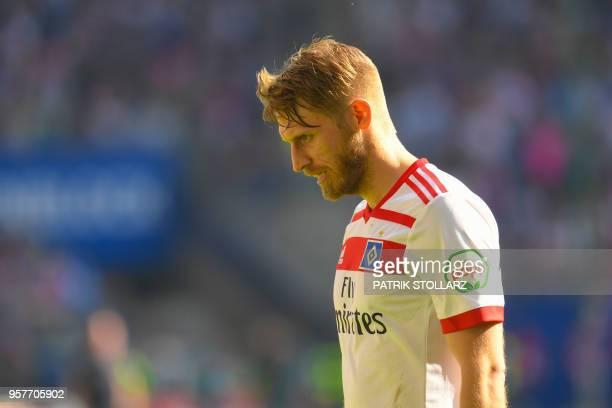 Hamburg's German midfielder Aaron Hunt reacts on the pitch after the German first division Bundesliga football match Hamburger SV vs Borussia...
