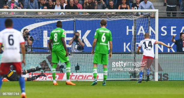 Hamburg's German midfielder Aaron Hunt scores by penalty during the German first division Bundesliga football match Hamburger SV vs Borussia...