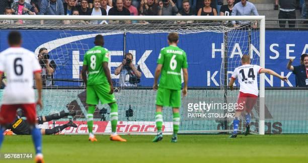 Hamburg's German midfielder Aaron Hunt scores by penalty during the German first division Bundesliga football match Hamburger SV vs Borussia...