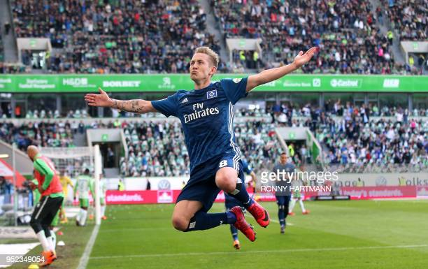 TOPSHOT Hamburg«s German midfielder Lewis Holtby celebrates after scoring his team's second goal during the German first division Bundesliga football...