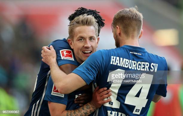 Hamburg's German midfielder Lewis Holtby celebrates after scoring his team's second goal with German midfielder Aaron Hunt and Hamburg's German...