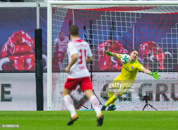 Hamburg's goalkeeper Christian Mathenia fails to save the first goal by Leipzig's Portuguese forward Bruma during the German first division...