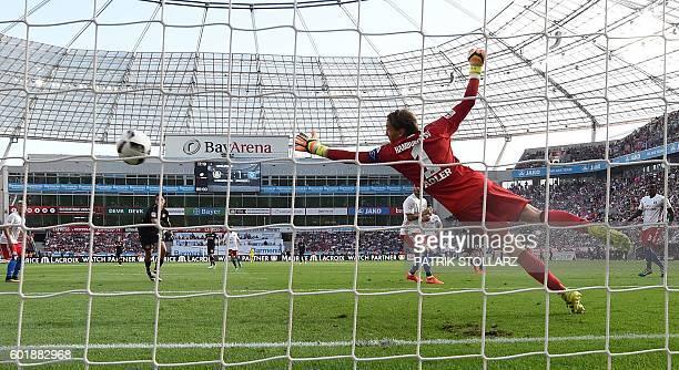 Hamburg's goalkeeper Rene Adler missies a goal from Leverkusen´s Joel Pohjanpalo during German first division Bundesliga football match between Bayer...
