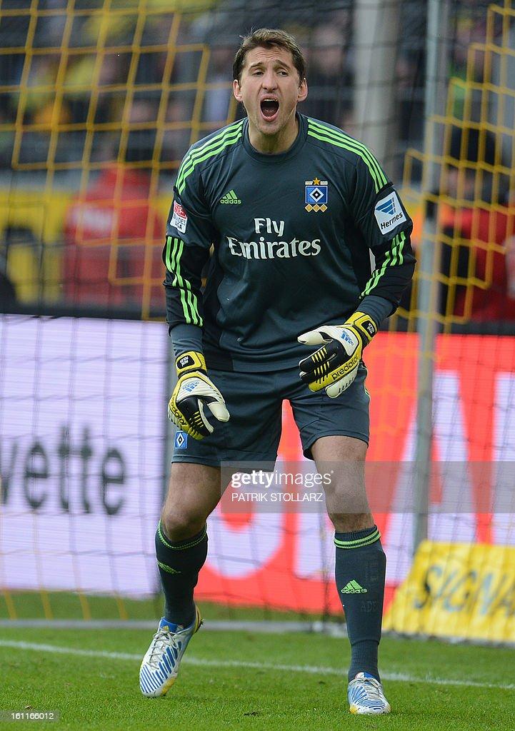 Hamburg's goalkeeper Rene Adler reacts during the German first division Bundesliga football match Borussia Dortmund vs Hamburger SV in Dortmund, western Germany, on February 9, 2013. Hamburg won 1-4.