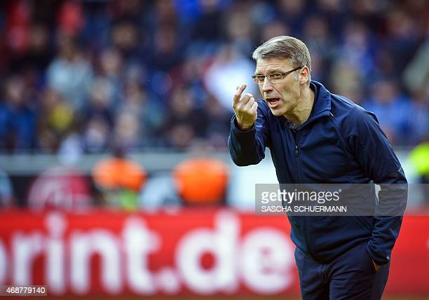 Hamburg's head coach Peter Knaebel reacts during the German first division Bundesliga football match Bayer 04 Leverkusen vs Hamburg SV in Leverkusen,...