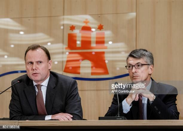 Hamburg's Interior Minister Andy Grote and Hamburg's police president Ralf Martin Meyer give a press conference on July 29 2017 in Hamburg northern...