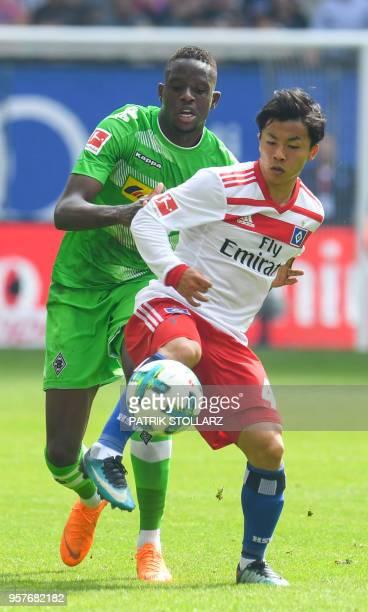 Hamburg's Japanese midfielder Tatsuya Ito and Moenchengladbach's French defender Mamadou Doucoure during the German first division Bundesliga...