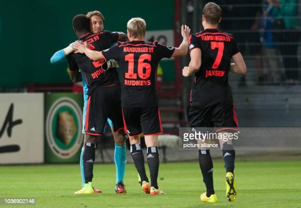 Hamburg's Johan Djourou , Artjoms Rudnevs , Marcell Jansen run to goalkeeper Rene Adler during the DFBCup first round match between FCEnergie...