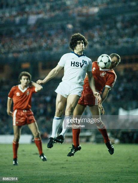 SV Hamburg's Kevin Keegan with Nottingham Forest captain John McGovern watched by Martin O'Neill during the European Cup Final at the Bernabeu...