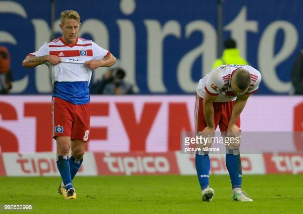 Hamburg's Lewis Holtby and Hamburg's Kyriakos Papadopoulos leave the pitch after the German Bundesliga soccer match between Hamburger SV and Bayern...