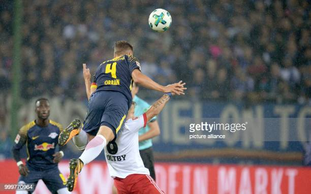 Hamburg's Lewis Holtby  and Leipzig's Willi Orban vie for the ball during the Bundesliga soccer match between Hamburg SV and RB Leipzig in the...