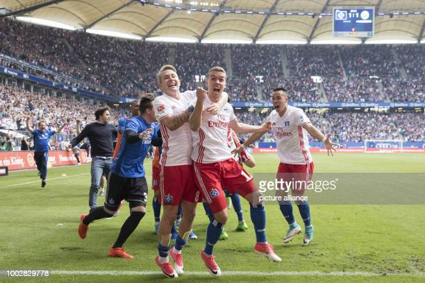 Hamburg's Lewis Holtby GianLuca Waldschmidt and Bobby Wood celebrate Waldschmidt's goal awarding Hamburg the 21 victory during the German Bundesliga...