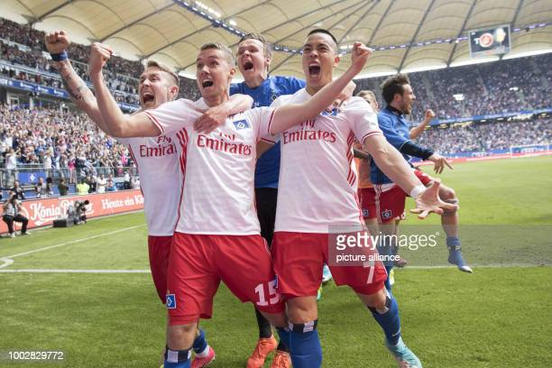 Hamburg's Lewis Holtby GianLuca Waldschmidt goalie Andreas Hirzel and Bobby Wood celebrate Waldschmidt's goal awarding Hamburg the 21 victory during...