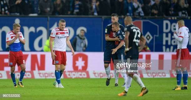 Hamburg's Lewis Holtby Hamburg's Kyriakos Papadopoulos Munich's Joshua Kimmich Munich's Arturo Vidal and Hamburg's Bobby Wood leave the pitch after...