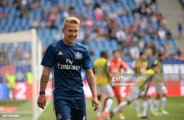 Hamburg's Lewis Holtby stands on the pitch during the friendly match between Hamburger SV and Espanyol Barcelona in the Volkspark Stadium in Hamburg...