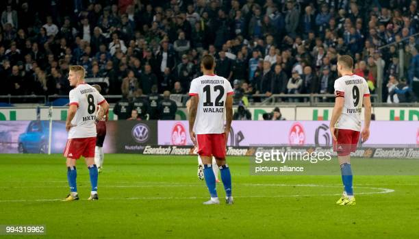 Hamburg's Lewis Holtby Walace and Kyriakos Papadopoulos stand on the pitch during the German Bundesliga soccer match between Hannover 96 and...