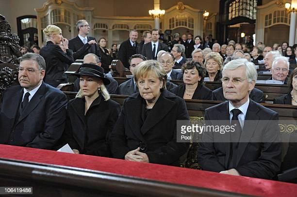 Hamburg's Mayor Christoph Ahlhaus his wife Simone German Chancellor Angela Merkel former Hamburg Mayor Henning Voscherau attend the memorial service...