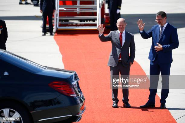 Hamburgs Mayor Olav Scholz and Hamburg's G20CoOrdinator Wolfgang Schmidt wave after Chinese President Xi Jinping arrived at Hamburg Airport for the...