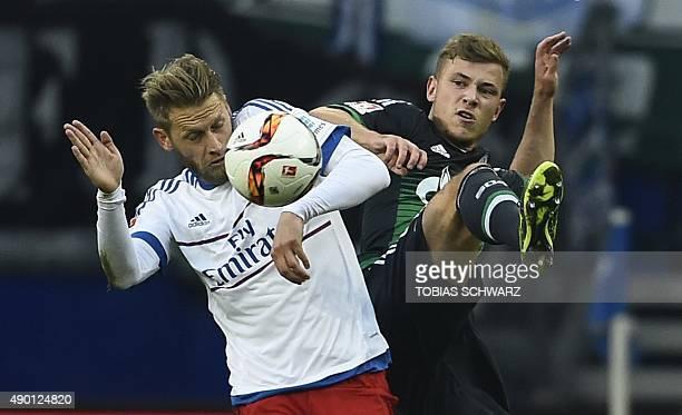 Hamburg's midfielder Aaron Hunt and Schalke's midfielder Max Meyer vie for the ball during the German first division Bundesliga football match...