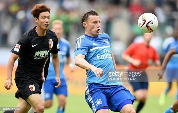 Hamburg's midfielder Ivica Olic and Augsburg's South Korean defender JeongHo Hong vie for the ball during the German Telkom Cup 2015 final football...