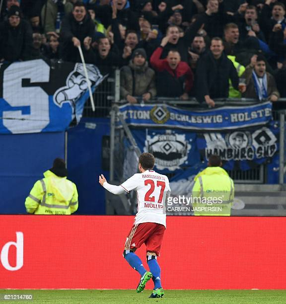 Hamburg's midfielder Nicolai Mueller celebrate scoring during the German first division Bundesliga football match between Hamburg SV and BVB Borussia...