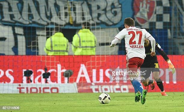 Hamburg's midfielder Nicolai Mueller scores during the German first division Bundesliga football match between Hamburg SV and BVB Borussia Dortmund...