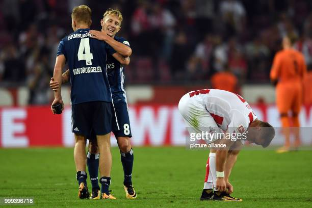 Hamburg's Rick van Drongelen and Lewis Holtby celebrate their 13 victory over Cologne next to Cologne's Christian Clemens after the German Bundesliga...