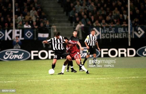 SV Hamburg's Rodolfo Cardoso and Juventus' Alessio Tacchinardi battle for the ball