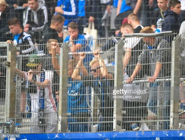Hamburg's supporters react after the German first division Bundesliga football match Hamburger SV vs Borussia Moenchengladbach in Hamburg nothern...