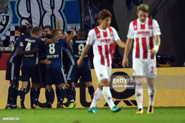 Hamburg's team celebrates the 13 goal by Lewis Holtby during the German Bundesliga soccer match between 1 FC Cologne and Hamburger SV in the...