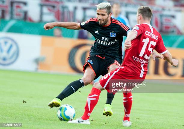 Hamburg's Valon Behrami and Cottbus' Nikolas Ledgerwood in action during the DFB Cup first round match between FC Energie Cottbus and Hamburg SV at...
