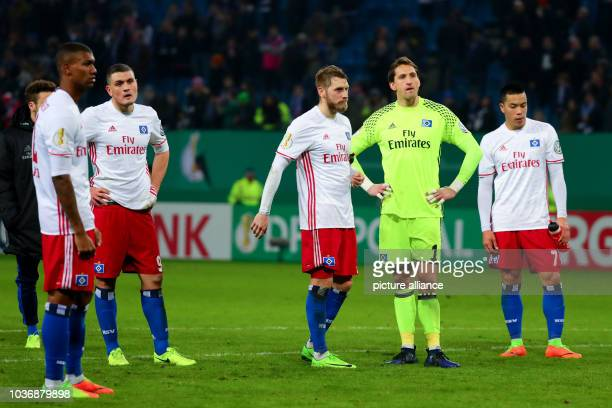 Hamburg's Walace Kyriakos Papadopoulos Aaron Hunt goalkeeper Réne Adler and Bobby Wood standing on the field after their loss at the DFB Cup quarter...