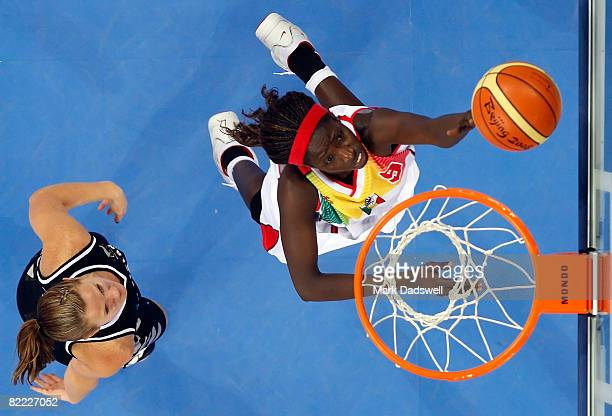 Hamchetou Maiga of Mali goes up for a layup during the women's preliminary basketball game against New Zealand at the Beijing Olympic Basketball...