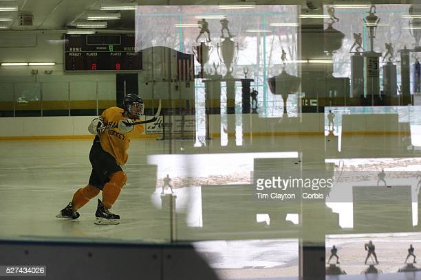 Hamden High School ice hockey players during a training session at Hamden High School with the trophy cabinet reflected in the ringside glass Hamden...