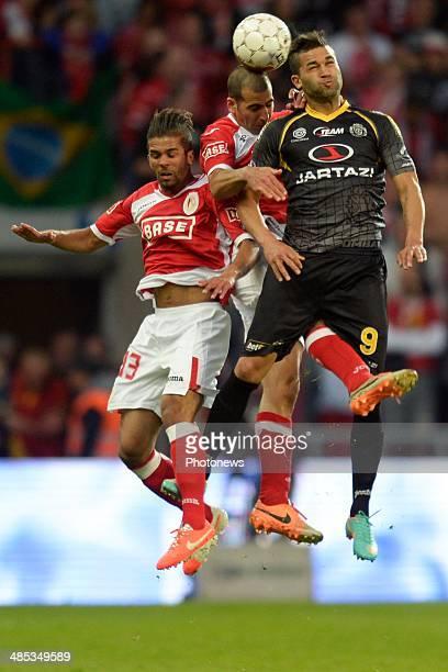 Hamdi Harbaoui of Sporting Lokeren OVL battles for the ball with Mehdi CarcelaGonzalez of Standard and Tal Ben Haim of Standard during the Jupiler...