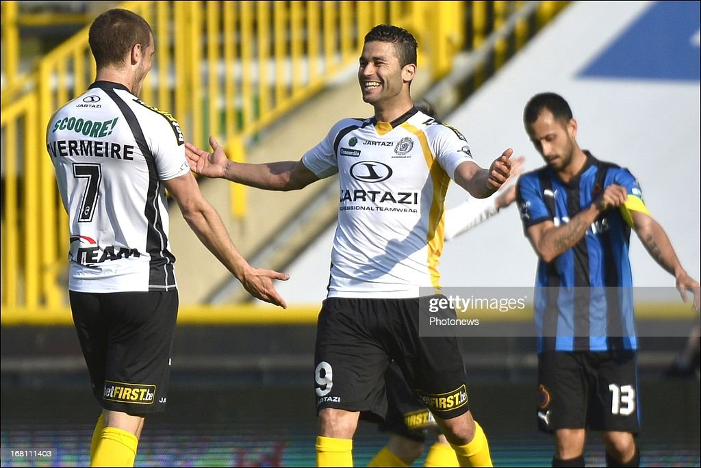 Hamdi Harbaoui (C) of Sporting Lokeren OVL celebrates after scoring a goal during the Jupiler Pro League play-off 1 match between Club Brugge and Sporting Lokeren on May 5, 2013 in Brugge, Belgium.