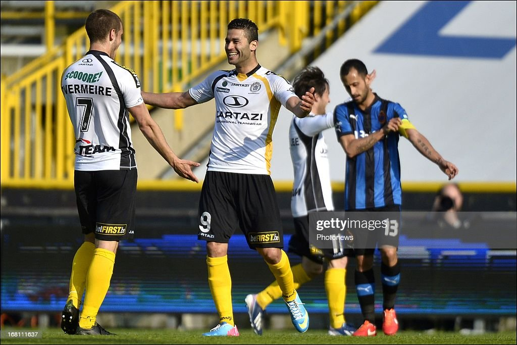 Hamdi Harbaoui (2nd L) of Sporting Lokeren OVL celebrates after scoring a goal during the Jupiler Pro League play-off 1 match between Club Brugge and Sporting Lokeren on May 5, 2013 in Brugge, Belgium.