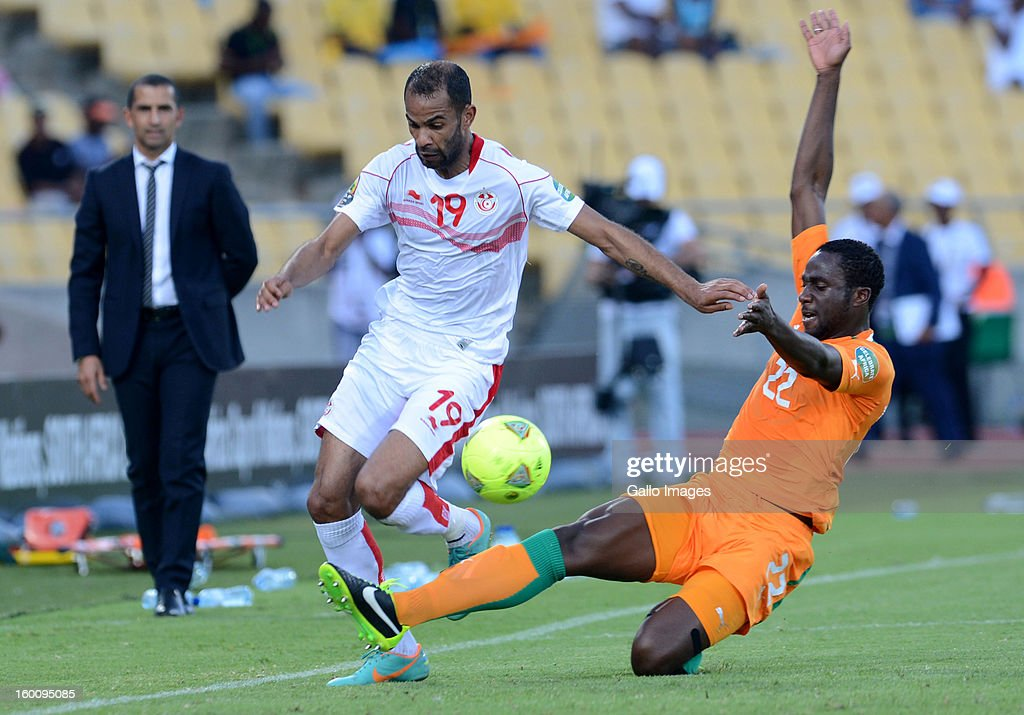 Hamdi Harbaoui of Tunisia and Ali Rial of Ivory Coast (R) during the 2013 African Cup of Nations match between Ivory Coast and Tunisia at Royal Bafokeng Stadium on January 26, 2013 in Rustenburg, South Africa.