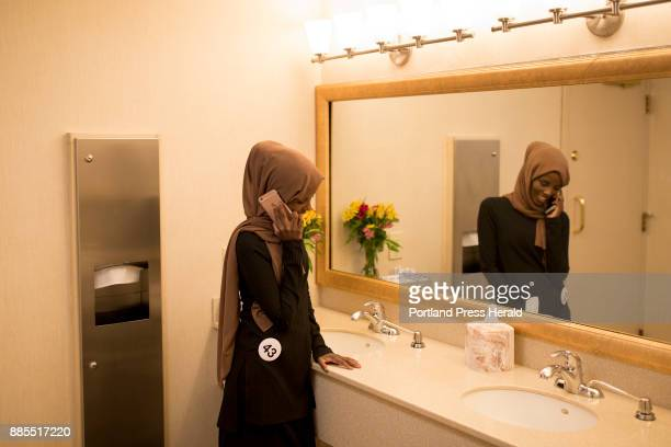 Hamdia Ahmed calls her mom in the bathroom during a break in rehearsals the second day of the Miss Maine USA pageant