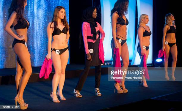 Hamdia Ahmed center wears a burkini on stage during the swimsuit competetion during the first night of Miss Maine USA pageant Ahmed was the first...