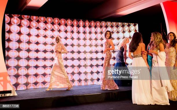 Hamdia Ahmed far left smiles at her family off stage after the first night of the Miss Maine USA pageant Her mother sister and four nieces came both...