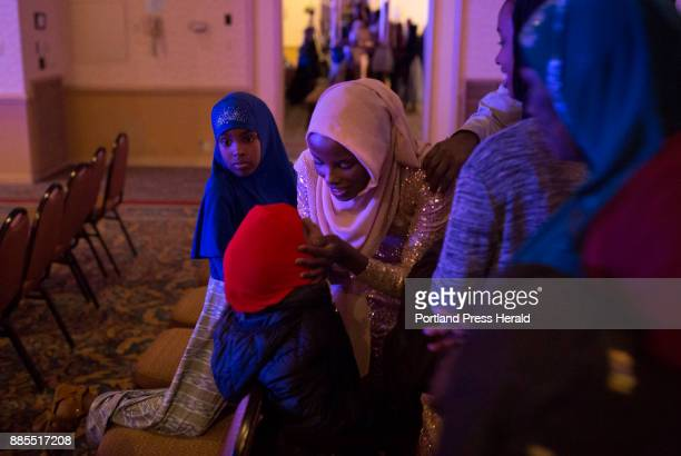 Hamdia Ahmed leans down to give her niece Zaytuun a kiss as her family surrounds her to congratulate her at the end of the twoday Miss Maine USA...