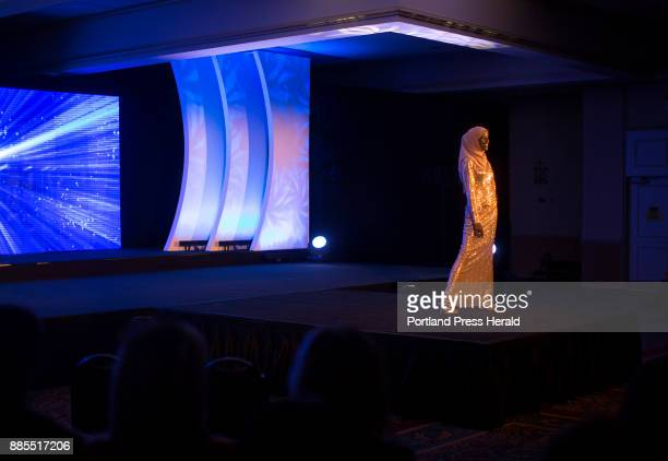 Hamdia Ahmed poses at the front of the stage during the evening gown portion of the Miss Maine USA pageant Ahmed hopes to become a model while...